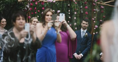 photographer-wedding-guest-phones